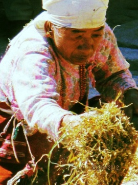 Woman with paddy husks